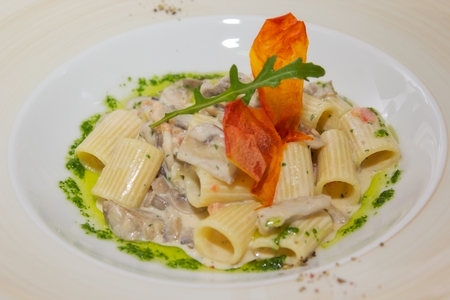 Pasta with seafood and cheese sauce photo