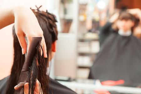 creating hairstyles hairdresser at salon. indoor shot Stock Photo