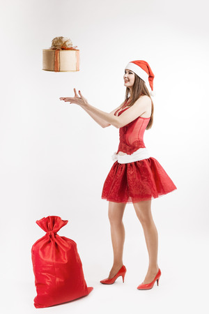 santa girl with gifts in the studio