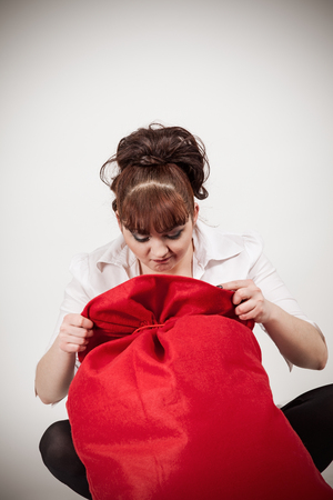 foretaste: girl with a bag of Santa Claus Stock Photo