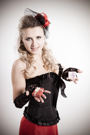 attractive girl in corset with gifts photo