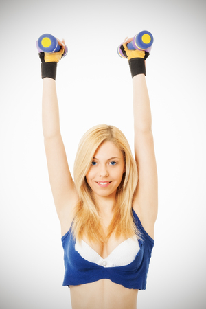 Attractive girl doing sport exercises photo