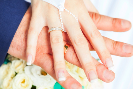 rings on hands. symbol of marriage photo