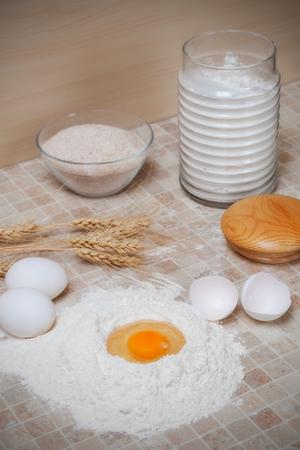 eggs, flour and ears on the table photo