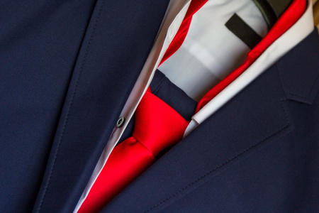 mens blue suit and red tie photo