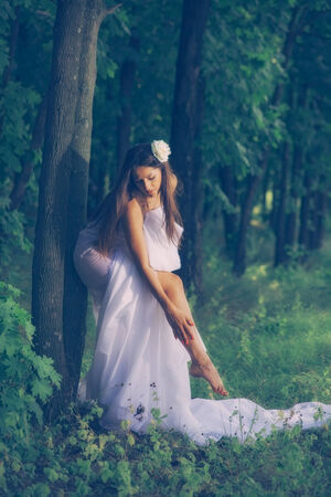 girl wrapped in white fabric. outdoor shot photo