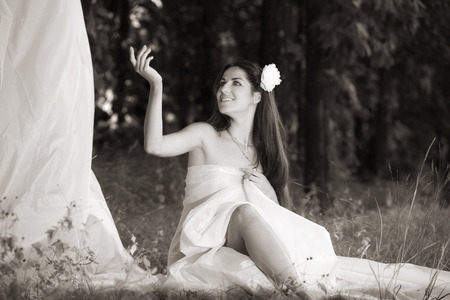 outdoor shot: girl wrapped in white fabric. outdoor shot
