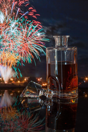whiskey bottle on a background of fireworks photo