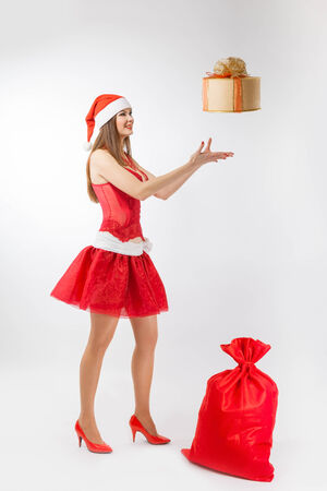 santa girl with gifts in the studio photo