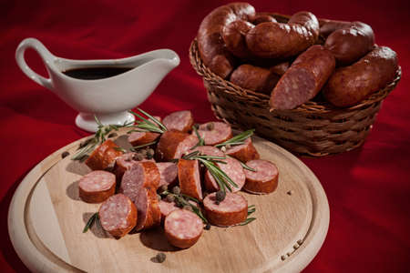appetizing sliced sausage on a cutting board photo