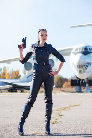 aircraft rivets: portrait of attractive woman near plane Stock Photo