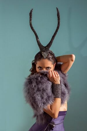 fashionable woman with fur and horns