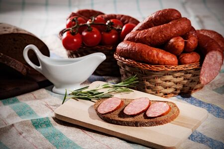 still life with sliced sausage and bread photo