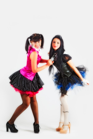 up skirt: Two attractive girls in the costumes of anime Stock Photo
