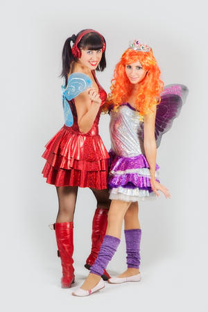 cosplay: Two attractive girls in anime costumes with wings