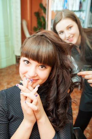 indoor shot: creating hairstyles hairdresser at salon. indoor shot Stock Photo
