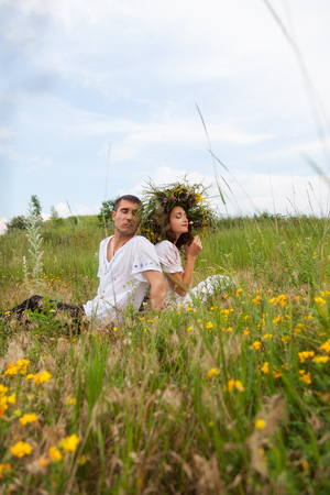 guy and girl on the meadow photo