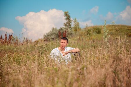 serious guy in a meadow photo