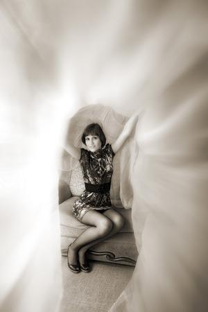 indoor shot: attractive woman sitting on sofa. indoor shot