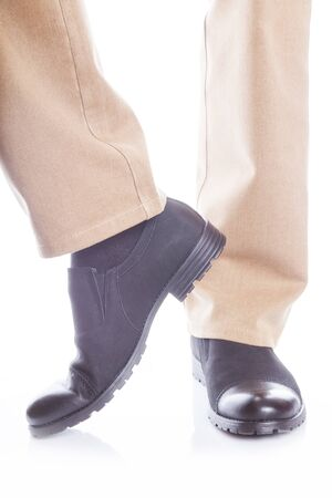 khaki pants: male legs in jeans and shoes on white background
