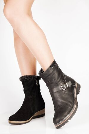 buckles: Beautiful female legs in the different leather boots with buckles