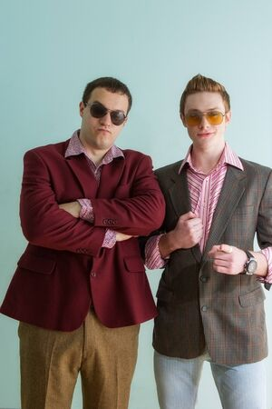 sleazy: two guys with glasses and retro costumes. portraits