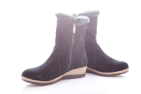 buckles: Beautiful, black boots with zips and buckles made of suede. On a white background.