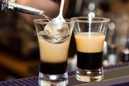three layer: B-52 Preparation of three-layered drink. close-up Stock Photo