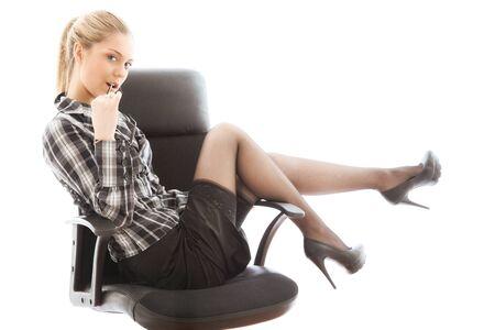 Beautiful sexy businesswoman on armchair. portrait