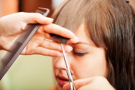 creating hairstyles hairdresser at salon. indoor shot Zdjęcie Seryjne