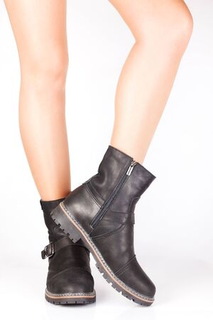 buckles: Beautiful female legs in mens leather boots with buckles