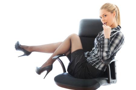 businesswoman legs: Beautiful sexy businesswoman on armchair. portrait