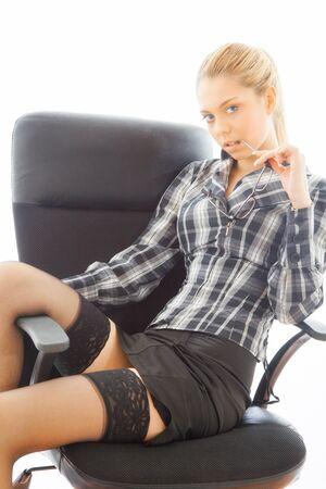 sexy businesswoman: Beautiful sexy businesswoman on armchair. portrait