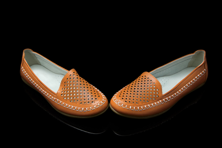 loafer: Orange women loafer isolated on black background