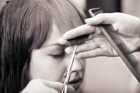 salon: creating hairstyles hairdresser at salon. indoor shot Stock Photo