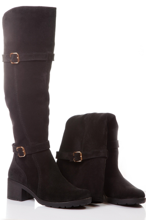 buckles: Beautiful, tall black boots with zips and buckles made of suede. On a white background.