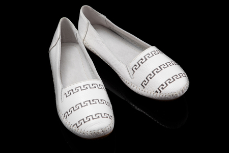 loafer: White women loafer isolated on black background