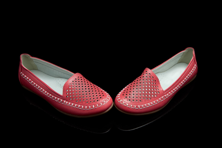 loafer: Red women loafer isolated on black background