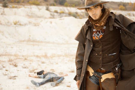 dueling pistol: duel between cowboys. affair of honor Stock Photo