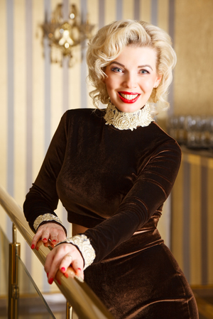 Beautiful blonde girl in a luxurious interior Stock Photo
