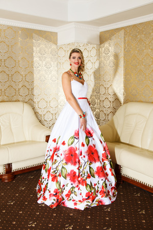 Portrait of attractive blonde woman in formal dress