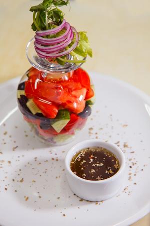 Beautiful, appetizing Greek salad of European cuisine. close-up Stock Photo