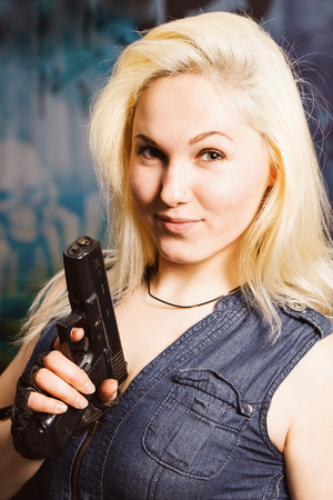 army face: Portrait of attractive woman in military style Stock Photo