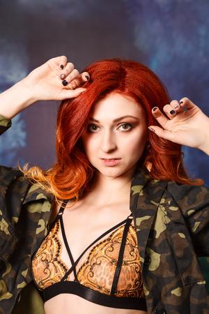 Beautiful seductive redhead in lingerie Stock Photo
