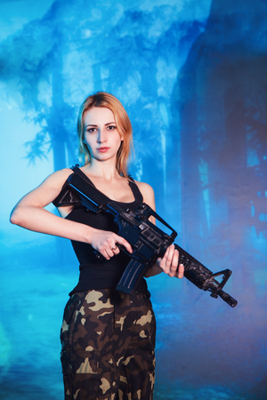 Portrait of attractive woman in military style Stock Photo