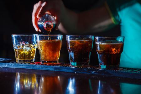 Preparation of long cocktails. Close-up