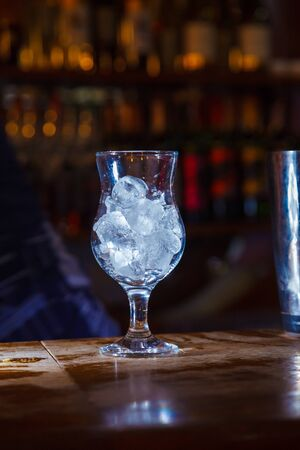 glass of ice on the bar. close-up Stock Photo