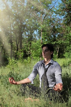 young guy on nature meditates Stock fotó
