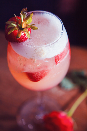 alcohol drink with strawberry on bar. cocktail Stock Photo