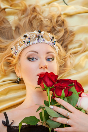 Beautiful blond in black lingerie with roses Stock Photo - 97322388